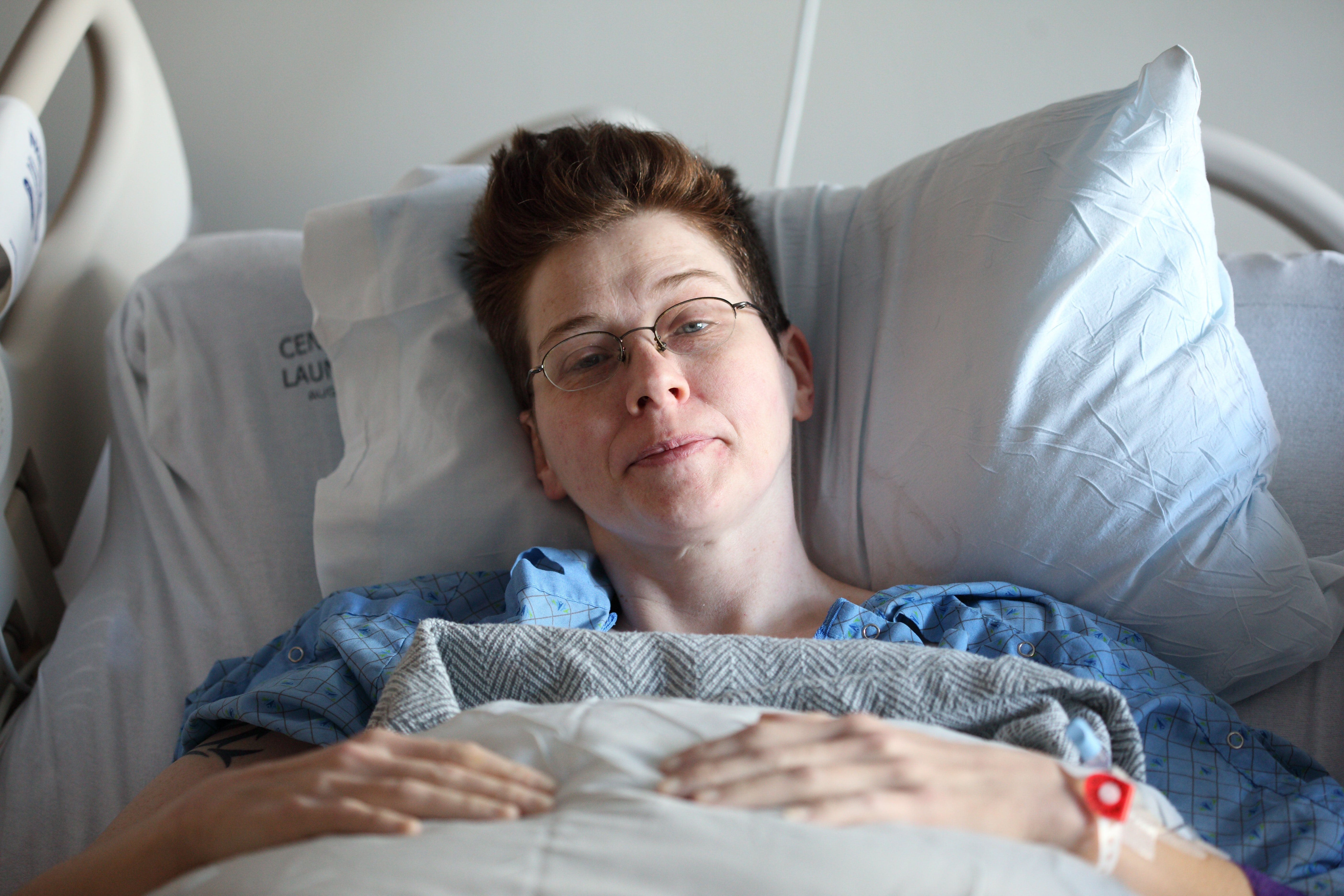 Woman with autoimmune disease in hospital bed